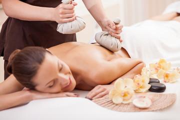 Obraz na płótnie Canvas Cheerful lady is getting skin care treatment