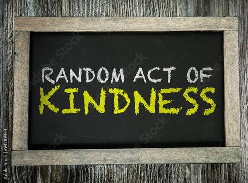 Random Act of Kindness written on chalkboard Canvas Print