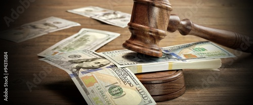 Judges or Auctioneer Gavel And Money On The Wooden Table Canvas Print