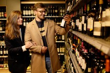 Couple Choosing Alcohol In A L...