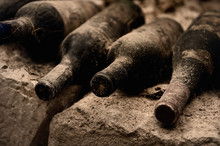 Old Wine Bottles On A Stone St...