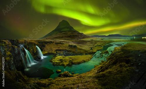 Photo  Aurora at Kirkjufell and Waterfall Kirkjufellsfoss, Landmark of