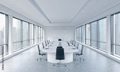 Photo  A bright modern panoramic meeting room in a modern office with Singapore view