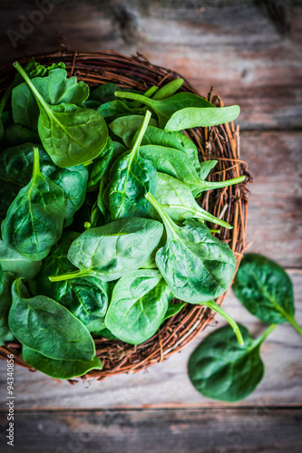 Fotografie, Obraz  Fresh spinach on rustic wooden background