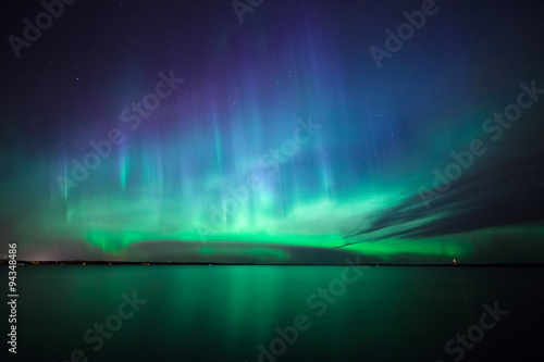 Poster Noorderlicht Northern lights over lake in finland