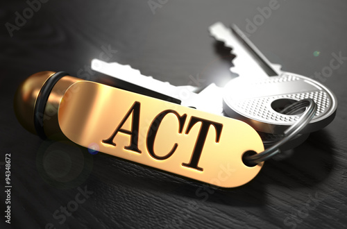 Fotografía  Act - Bunch of Keys with Text on Golden Keychain.