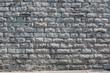 Hintergrund –Natursteinmauermit eckigen Steinen