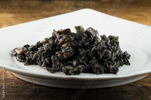 Fotografie, Obraz  Riso, risotto al nero di seppia, risotto con seppie e gamberetti risotto al pesc