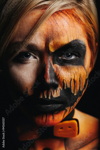 Halloween Portrait Of Body Art Pumpkin Girl With Pumpkin Bowtie On Black Background Real Greasepaint And Face Art Makeup Straight Look And Black Lips Buy This Stock Photo And Explore Similar