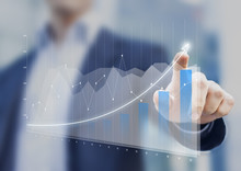 Financial Charts Showing Growing Revenue On Touch Screen