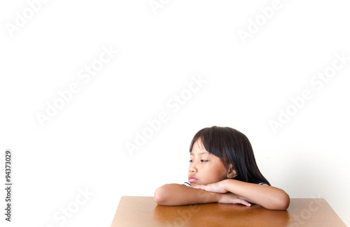 Fotografia, Obraz  Bored children girl sitting at the table