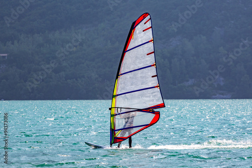 obraz lub plakat Windsurfer on the lake