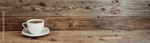 Fototapeta cup of coffee on wooden background obraz