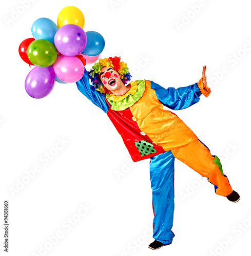 Happy birthday clown holding a bunch of balloons. Fototapeta