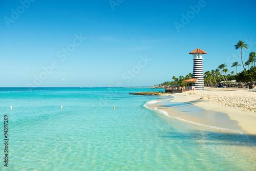 Foto op Plexiglas Caraïben Paradise Caribbean landscape. Clear sea, white sand, tropical palm trees and lighthouse on sandy shore