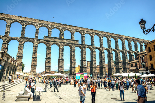 Segovia, Spain - June 29, 2014: People around the famous ancient
