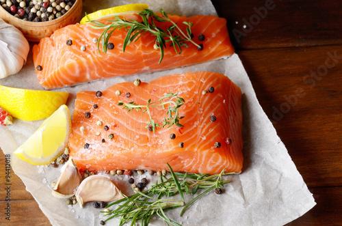 Papiers peints Poisson Raw salmon on baking paper