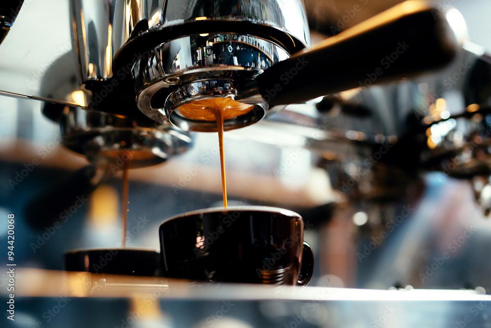 Preparing cup of cappuccino