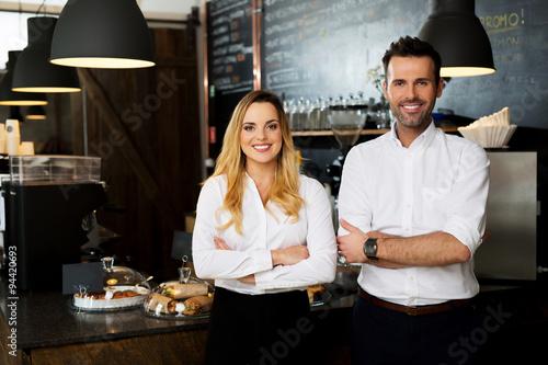 Fotobehang Restaurant Successful restaurant managers standing together