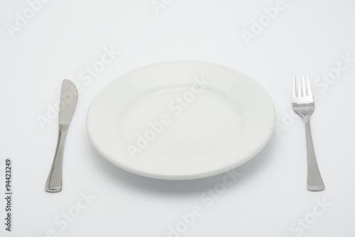 Spoed Foto op Canvas Klaar gerecht Plato vacío, tenedor y cuchillo