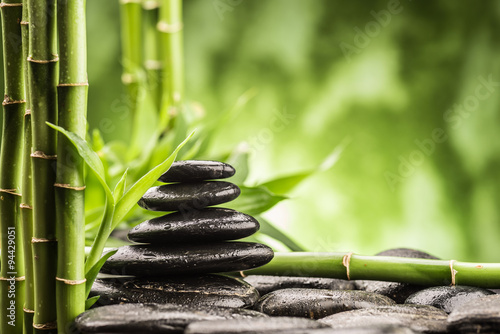 spa concept with zen basalt stones and bamboo