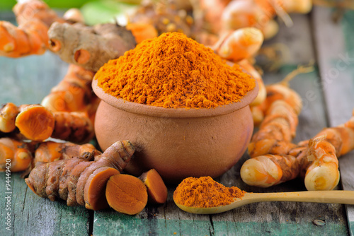 Fotografie, Tablou  turmeric roots in the basket on wooden table