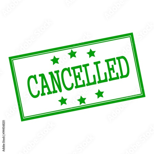 Fotografía  cancelled green stamp text on background white and star