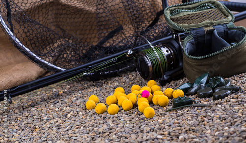 Fotografía  Boilies - Big Carp Fishing on background of river sand