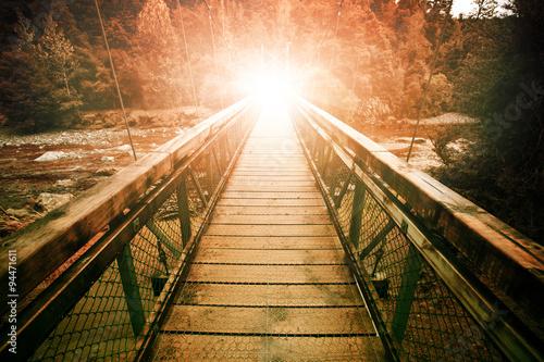 Keuken foto achterwand Bruggen warp light at the end of suspension bridge crossing steam in wil