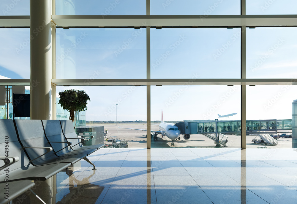 Fototapeta Airport terminal, people going to airplane in background