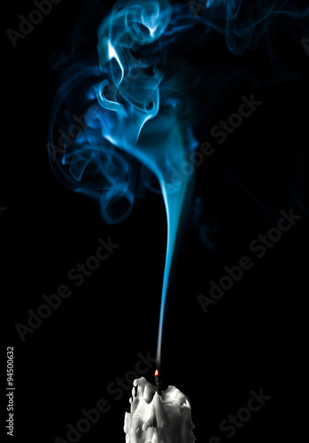 Fotografie, Obraz Extinguished fuming candle on a black background