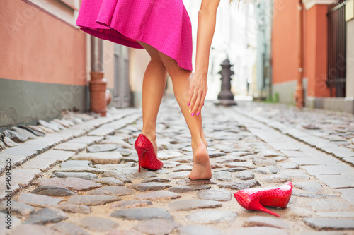 Stampa su Tela Woman injured ankle while wearing high heel shoes