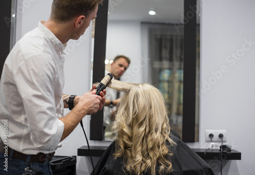 fototapeta na drzwi i meble Hairdresser working in hair salon