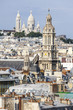 PARIS, FRANCE, on AUGUST 31, 2015. The top view from a survey platform on roofs of Paris, Holy Trinity Church and a cathedral Sakre-Ker on Montmartre