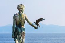 Maiden With The Seagull Statue In Opatija, Croatia.