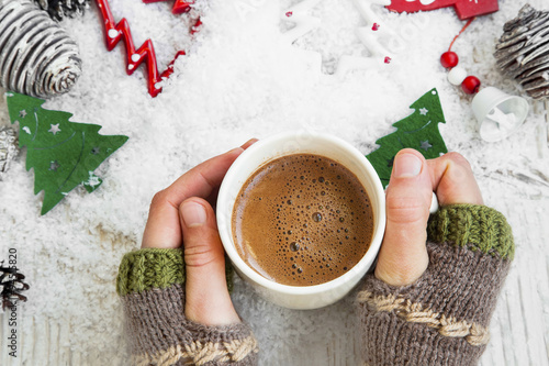 Foto op Canvas Chocolade Chocolate Mug on Christmas Time, Hands Holding Hot Cocoa Cup