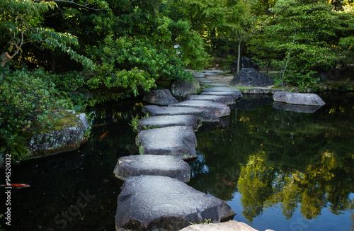Fotografie, Obraz  Step stones path over a pond in Koko-en Garden near White Egret Castle, in Himej