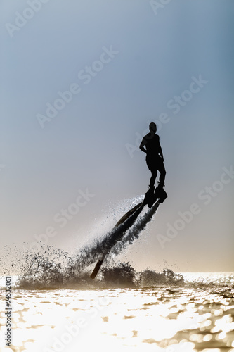 Spoed Foto op Canvas Water Motor sporten Silhouette of a fly board rider