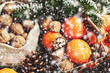 Christmas decoration with tangerines, xmas tree twigs and snowflakes