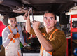 Mechanics repairing car of client