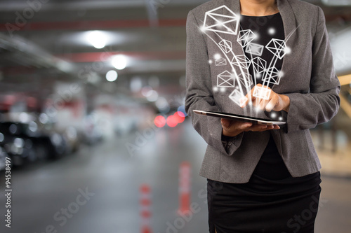 Fotografie, Obraz  Business woman sending email by using digital tablet