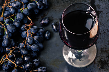 Wineglass of red wine with grapes