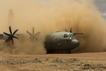 Air Force Plane Lands On Desert Field Airstrip To Deploy Troops