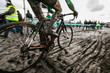 Cyclocross riderin a dirty track