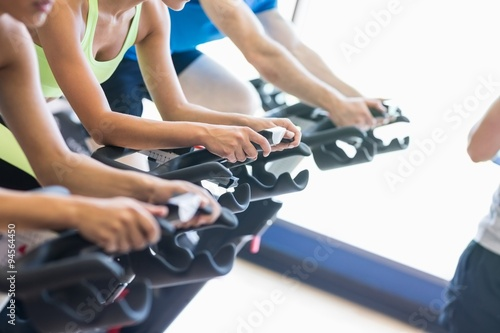Fotografia Fit people in a spin class