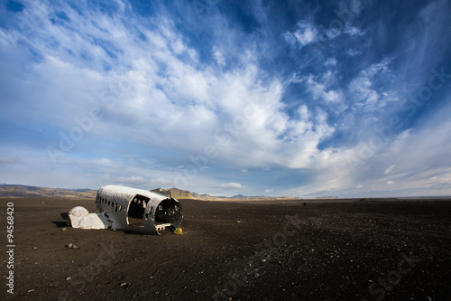 Photo  Airplane wreckage on black sand beach. Douglas Dakota DC3, US na