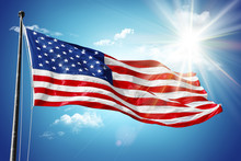American Flag In Blue Sky And Sunshine Background