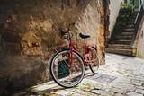 Fototapeta Uliczki - Abandoned bike on the Italian street in the old Tuscany
