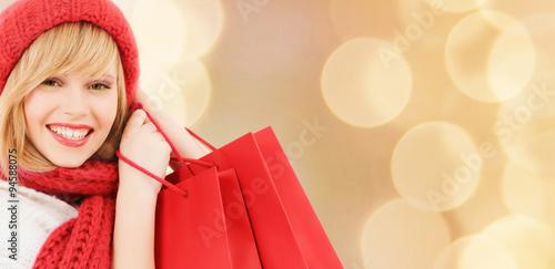 smiling young woman with shopping bags Billede på lærred