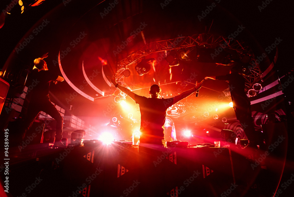 photo art print dj hands up in night club party background